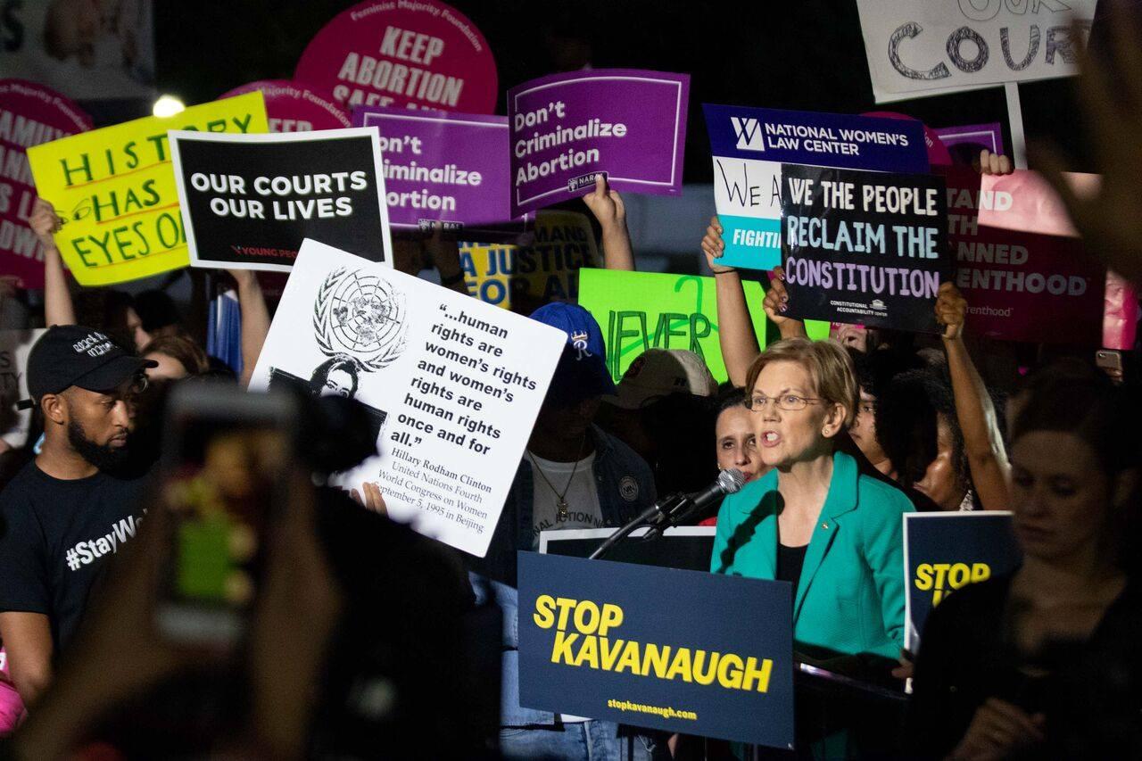 Elizabeth Warren speaking at a Stop Kavanaugh rally