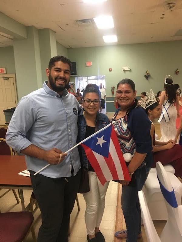 Three people celebrating the Semana Hispana in Lawrence – a fun festival celebrating Hispanic unity and strength