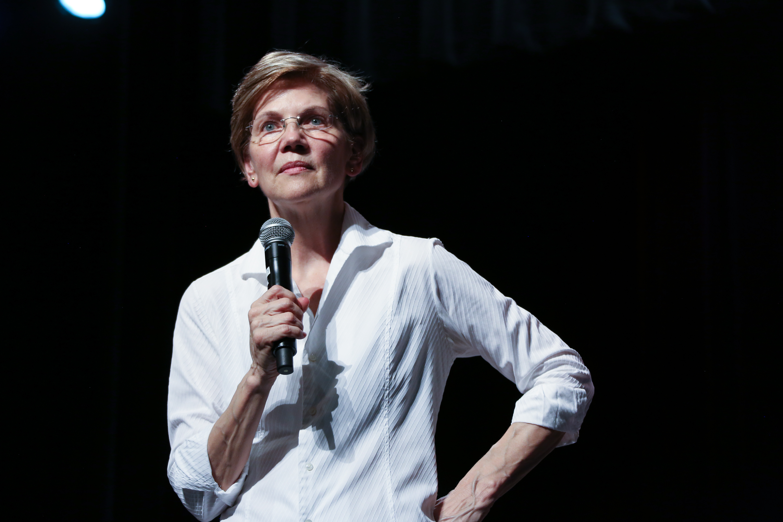 Elizabeth Warren standing holding a microphone