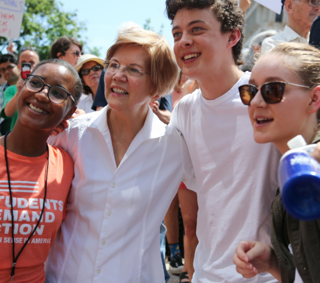 Elizabeth Warren posting with students at the Family Reunification rally